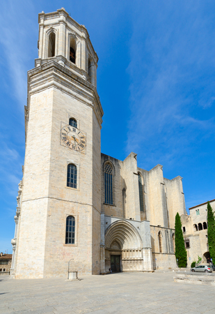 GIRONA, SPAIN - SEPTEMBER 11, 2018: Unknown man is located near gothic Cathedral in historic center of Girona, Spain