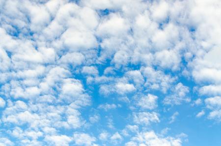 Cirro-cumulus clouds in summer blue sky, background