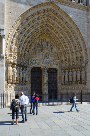 PARIS, FRANCE - SEPTEMBER 7, 2018: Unknown tourists are at famous Notre Dame de Paris, France