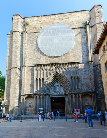 BARCELONA, SPAIN - SEPTEMBER 13, 2018: Unidentified tourists are near Basilica of Santa Maria del Pi in famous Gothic Quarter, Barcelona, Spain