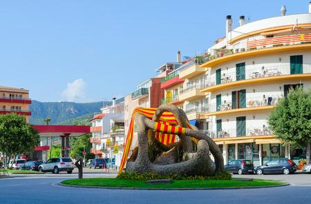 TOSSA DE MAR, SPAIN - SEPTEMBER 12, 2018: Modern sculpture Love of two octopuses on Placa de les Nacions Sense Estat in resort town of Tossa de Mar, Spain