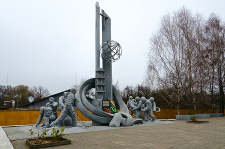 CHERNOBYL, UKRAINE - NOVEMBER 11, 2018: Monument to firefighters who participated in liquidation of consequences of accident at Chernobyl nuclear power plant (