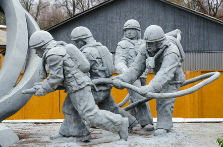 CHERNOBYL, UKRAINE - NOVEMBER 11, 2018: Fragment of monument to firefighters who participated in liquidation of consequences of accident at Chernobyl nuclear power plant (