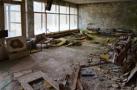 Hall in hospital No. 126, dead ghost town of Pripyat in alienation zone of Chernobyl nuclear power plant, Ukraine 版權商用圖片