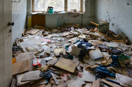 Medical documentation on floor in hospital No. 126, dead abandoned ghost town Pripyat in Chernobyl NPP alienation zone, Ukraine 版權商用圖片