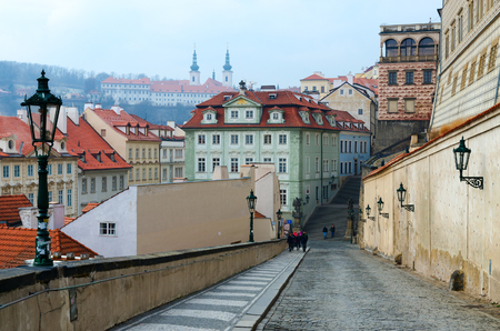 PRAGUE, CZECH REPUBLIC - JANUARY 22, 2019: Historical center of Prague, Czech Republic. Unknown tourists go to Hradcany Square and Prague Castle Editorial