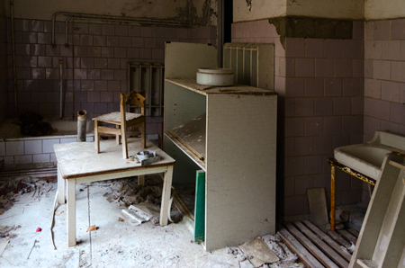 Room in abandoned kindergarten in dead ghost town of Pripyat in exclusion zone of Chernobyl nuclear power plant (after disaster, 32 years without people), Ukraine
