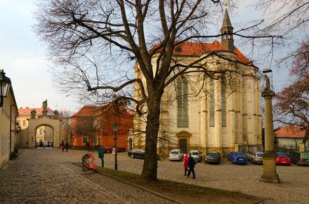 PRAGUE, CZECH REPUBLIC - JANUARY 22, 2019: Church of St. Roch (MIRO art gallery), Strahov Monastery. Unidentified people visit monastery courtyard