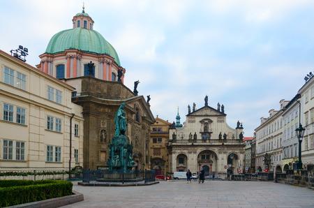 PRAGUE, CZECH REPUBLIC - JANUARY 22, 2019: Unknown tourists walk around Square of Crusaders. Church of St. Francis of Assisi, Church of St. Salvator, Prague, Czech Republic