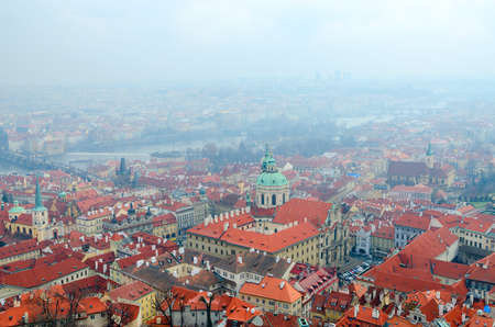 Beautiful top view of Church of St. Nicholas in historical center of Prague and Vltava River, Czech Republic
