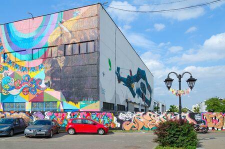 MINSK, BELARUS - AUGUST 12, 2019: Street art on Oktyabrskaya street. Graffiti on wall of industrial building, created as part of Vulica Brasil festival.