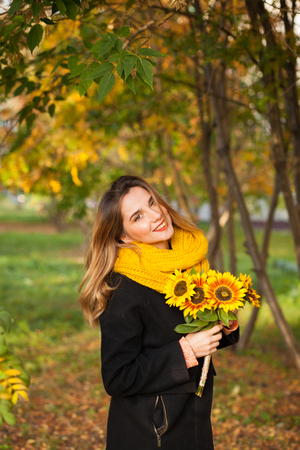 golden apple: Beautiful girl with sunflowers in the autumn rowan