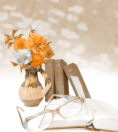 tinted glasses: Grunge postcard. Tinted card. Vase with flowers, few books, open book and glasses. Stock Photo