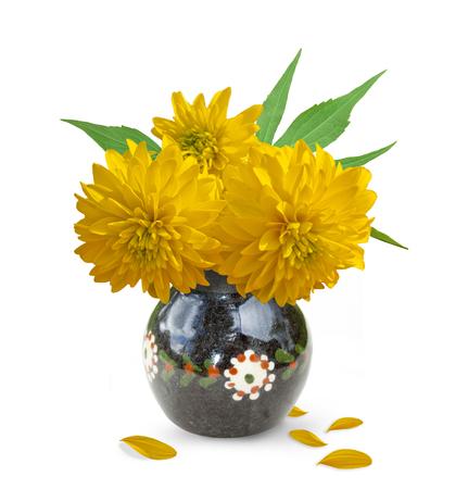 crock: Three yellow flower in a crock. Rudbeckia Stock Photo