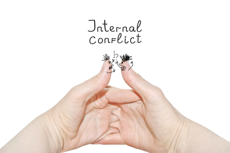 Internal conflict inscription.Two womens hands of the same person, interlock fingers on white background. Clasped Hands, Inner side close up