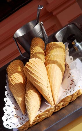 french way: Ice cream waffle cones and classic ice cream bucket on a cart in a French traditional way