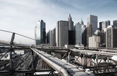 View over Manhattan, New York with Brooklyn bridge sections, rough industrial toning Stock Photo - 4476475