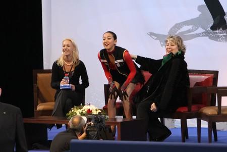 react: PARIS - OCTOBER 17: Mao ASADA (C) of Japan with her coach Tatiana TARASOVA (R) of Russia react in the Kiss & Cry at Eric Bompard Trophy October 17, 2009 at Palais-Omnisports de Bercy, Paris, France.