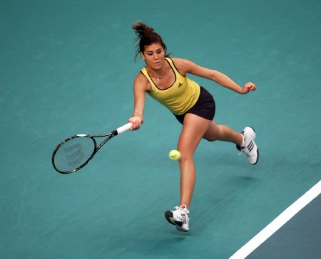PARIS - FEBRUARY 9: Sorana CIRSTEA of Romania returns the ball at Open GDF Suez 1st round match on February 9, 2010 in Paris, France