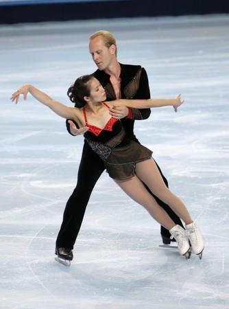 PARIS - OCTOBER 16: Rena INOUE and John BALDWIN of USA during pairs short skating event Eric Bompard Trophy October 16, 2009 at Palais-Omnisports de Bercy, Paris, France.