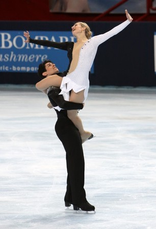 PARIS - OCTOBER 17: Kimberly NAVARRO and Brent BOMMENTRE of USA perform free dance at the ISU Grand Prix Eric Bompard Trophy October 17, 2009 at Palais-Omnisports de Bercy, Paris, France.