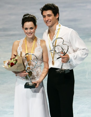 virtue: PARIS - OCTOBER 17: Tessa Virtue and Scott Moir (CAN) during the medal ceremony winning gold at Eric Bompard Trophy October 17, 2009 at Palais-Omnisports de Bercy, Paris, France. Editorial