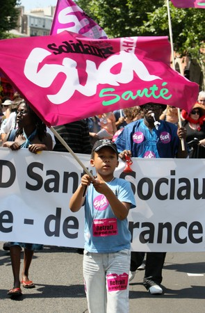 overhaul: PARIS - JUNE 24: A child protests during Frances nationwide strike against pension overhaul where bill raising the retirement age from 60 to 62 is to be voted in September on June 24, 2010 in Paris, France
