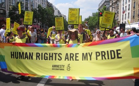 PARIS - JUNE 26: Amnesty International march in the Paris Gay Pride parade to support gay rights, on June 26, 2010 in Paris, France.