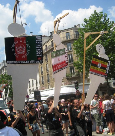PARIS - JUNE 26: The ECPM activists carry placards that symbolize gallows to protest death penalty in Afghanistan, Saudi Arabia, Arab Emirates; Iran; Mauritania;  Nigeria; Pakistan; Soudan and Yemen during the Paris Gay Pride, on June 26, 2010 in Paris, F