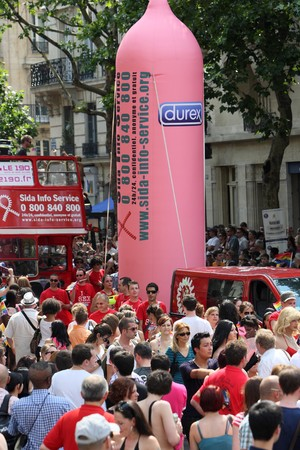 PARIS - JUNE 26: Activists of the AIDS Info Service organization display the giant Durex condom in the Paris Gay Pride parade, on June 26, 2010 in Paris, France.