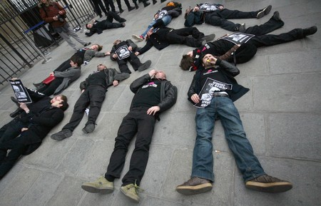 condoms: PARIS - MARCH 22: Members of the Act Up organisation lay down in front of Notre-Dame Cathedral to protest against Pope Benedict XVIs remarks on condoms and abortion during his current visit to Africa on March 22, 2009 in Paris, France