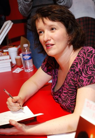 PARIS - MARCH 15: French comedian and actress ANNE ROMANOFF dedicates her books at the International Book Fair - Salon du Livre 2009 on March 15, 2009 in Paris, France