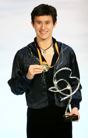PARIS - NOVEMBER 15: Canadian figure skater Patrick Chan poses during medal ceremony at ISU Grand Prix - Eric Bompard Trophy in Bercy, Paris, France on November 15, 2008. Stock Photo - 7737084