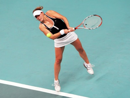 coubertin: PARIS - FEBRUARY 13: French tennis player Alize Cornet returns the ball during her quarter final match at Open GDF SUEZ WTA tournament, Pierre de Coubertin stadium on February 13, 2009 in Paris, France.