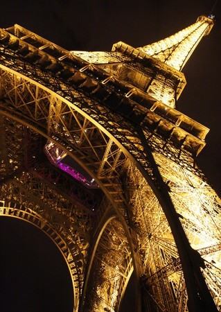 PARIS - FEBRUARY 25: Eiffel tower in Paris by night, closeup diagonal view from the base in Paris, France on February 25, 2009
