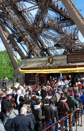 demanded: PARIS - APRIL 10: Thousands queue up for Eiffel Tower tickets after one and a half day strike, where personnel demanded better work conditions, April 10, 2009 in Paris, France. 500 workers daily service ca 18,000 tourists at the site.  Editorial