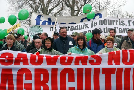 michel: PARIS - MARCH 25: French farmers demonstrate to protest against the plan of French agriculture minister Michel Barnier on the redistribution of the European financial aids on March 25, 2009 in Paris, France Editorial