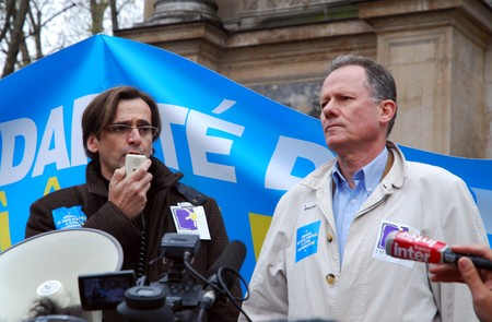 prohibits: PARIS - APRIL 8: Christian Deltombe (R), president of EMMAUS during manifestation agaist the law, which prohibits to provide aid to illegal immigrants, April 8, 2009 at St. Michel in Paris, France.