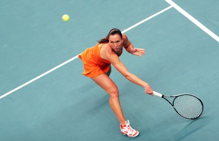 PARIS - FEBRUARY 13: Serbia's Jelena Jankovic returns the ball during her quarter final match at Open GDF SUEZ WTA tournament, Pierre de Coubertin stadium on February 13, 2009 in Paris, France. Stock Photo - 7737171