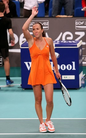 PARIS - FEBRUARY 11: Jelena Jankovic of Serbia thanks public after her match at Open GDF SUEZ WTA tournament, Pierre de Coubertin stadium on February 11, 2009 in Paris, France. Stock Photo - 7737172