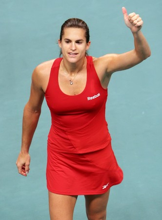 PARIS - FEBRUARY 13: French tennis player Amelie Mauresmo does thumbs up after winning her match at Open GDF SUEZ WTA tournament, Pierre de Coubertin stadium on February 13, 2009 in Paris, France. Stock Photo - 7737222