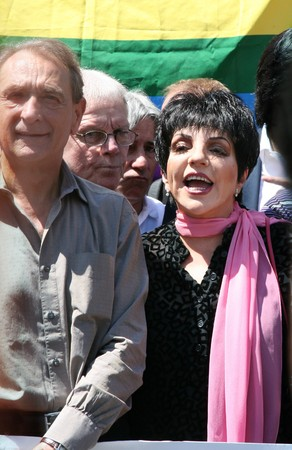 PARIS - JUNE 27: Liza Minnelli (R) and major of Paris Bertrand Delanoe (L)  in the front row of Paris Gay Pride parade to support gay rights, on June 27, 2009 in Paris, France.