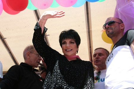 PARIS - JUNE 27: Liza Minnelli waves during Paris Gay Pride parade to support gay rights, on June 27, 2009 in Paris, France. Between 300,000 and 700,000 people took part in the parade.