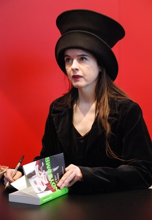novelist: PARIS - MARCH 14: FrenchBelgian fiction writer Amelie Nothomb signs her  book Tokyo Fiancee at the International Book Fair - Salon du Livre 2009 on March 14, 2009 in Paris, France