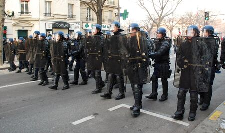 police equipment: PARIS - JANUARY 10: French police unit Gendarmerie escourts demonstration against war in Gaza strip on January 10, 2009 at Place de la Nation, Paris, France.