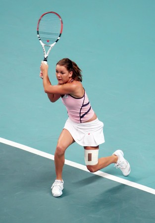 PARIS - FEBRUARY 13: Polish tennis player Agnieszka Radwanska returns the ball during her quarter final match at Open GDF SUEZ WTA tournament, Pierre de Coubertin stadium on February 13, 2009 in Paris, France. Stock Photo - 7737259