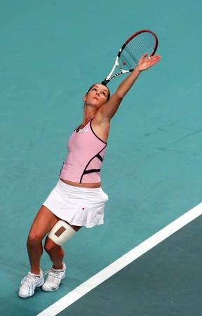 PARIS - FEBRUARY 13: Polish tennis player Agnieszka Radwanska serves during her quarter final match at Open GDF SUEZ WTA tournament, Pierre de Coubertin stadium on February 13, 2009 in Paris, France. Stock Photo - 7737260