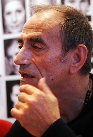 PARIS - MARCH 15: French actor, film director and singer - winner of 2 Cesar Awards Richard Bohringer dedicates his books at the International Book Fair - Salon du Livre 2009 on March 15, 2009 in Paris, France Editorial