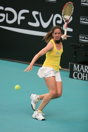 PARIS - FEBRUARY 11: Switzerland's tennis player Patty Schnyder aims to hit forehand at Open GDF SUEZ WTA tournament, Pierre de Coubertin stadium on February 11, 2009 in Paris, France. Stock Photo - 7737282