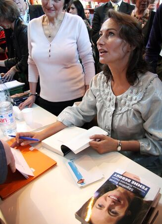 PARIS - MARCH 15: Former French socialist presidential candidate Segolene Royal dedicates her book Femme Debout (Standing Woman) during the 29th Paris Book Fair, on March 15, 2009 in Paris, France